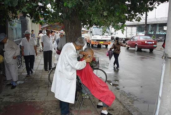 A street barber in Changchun. Picture taken Aug 10, 2005 by Pubert
